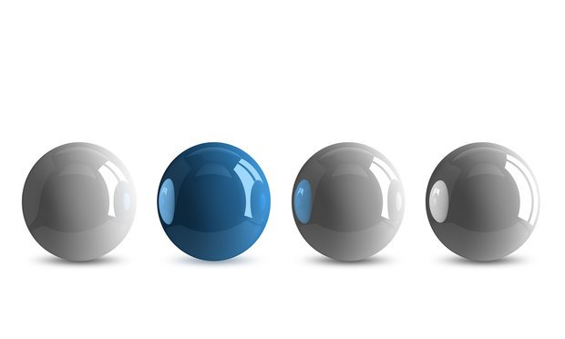 Blue shiny ball in row of white ones isolated on white background