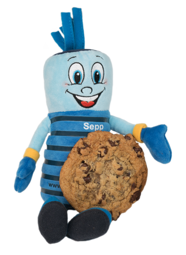 Picture of Schlemmer's Sepp mascot blue soft toy together with a cookie biscuit.