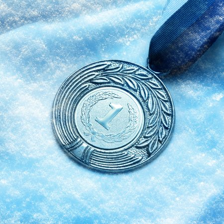 Metal medal with number 1 on snow background