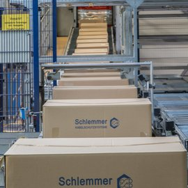 Schlemmer cable production boxes coming out of the production line in the Production Site Hassfurt
