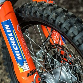 Macro view on KTM Rally Dakar Motorcycle Detail with Schlemmer Logo and tyre