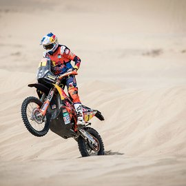 KTM Rally Dakar Rider doing a Bunny Hop in the middle of the desert